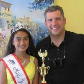 Traverse City pageant contestant Olympia Poses with dentist Brian Klym In Michigan
